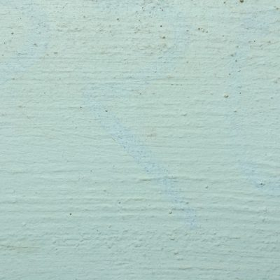 Concrete wall with teal paint featuring great texture