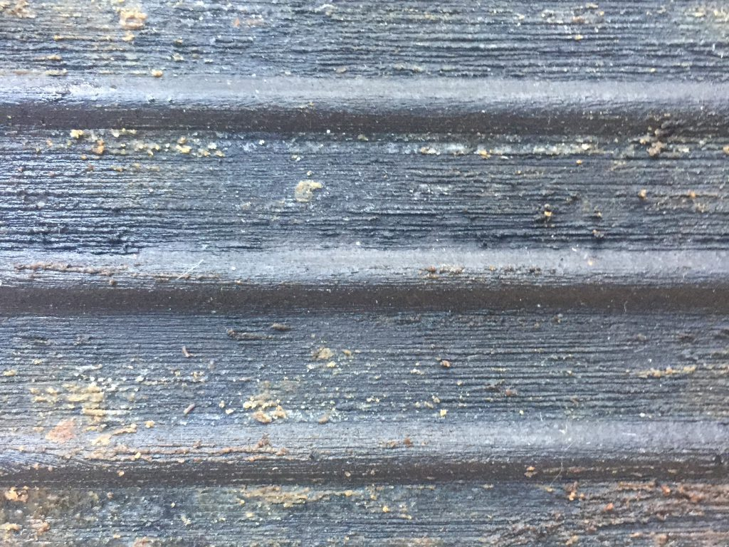 Charcoal grey dirty metal surface with horizontal lines