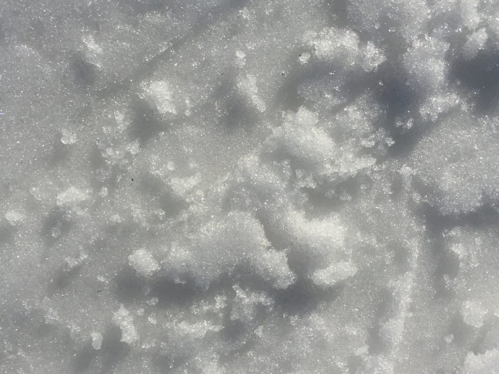 Sparkling white snow with layers of texture