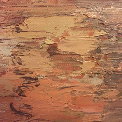 Thick layers of paint over canvas texture