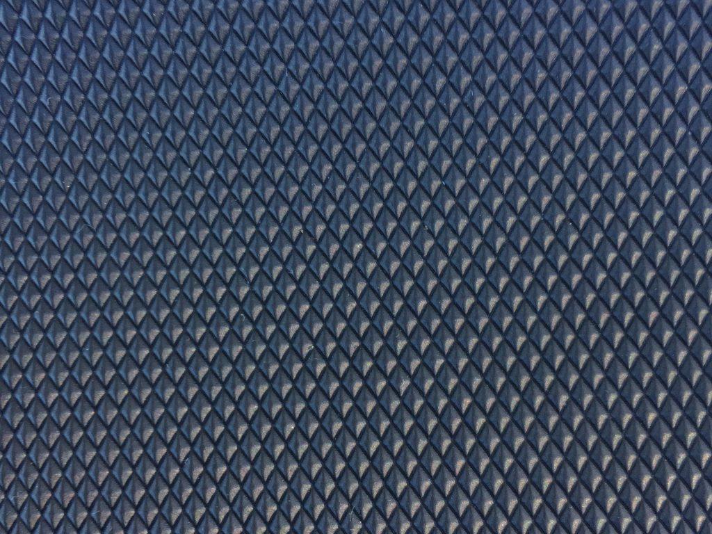 Dark plastic diamond pattern close up