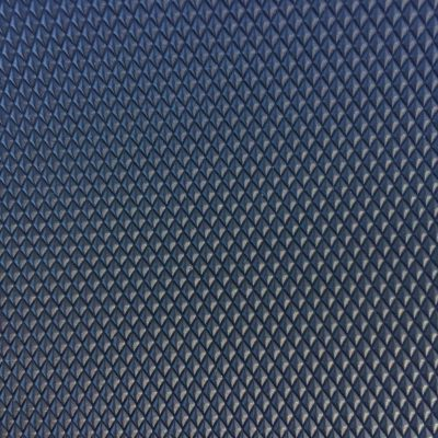 Dark plastic diamond pattern close up