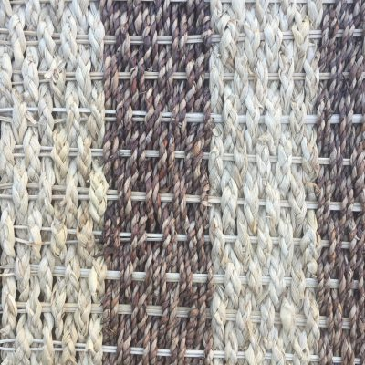 Tightly knit white and brown woven basket close up
