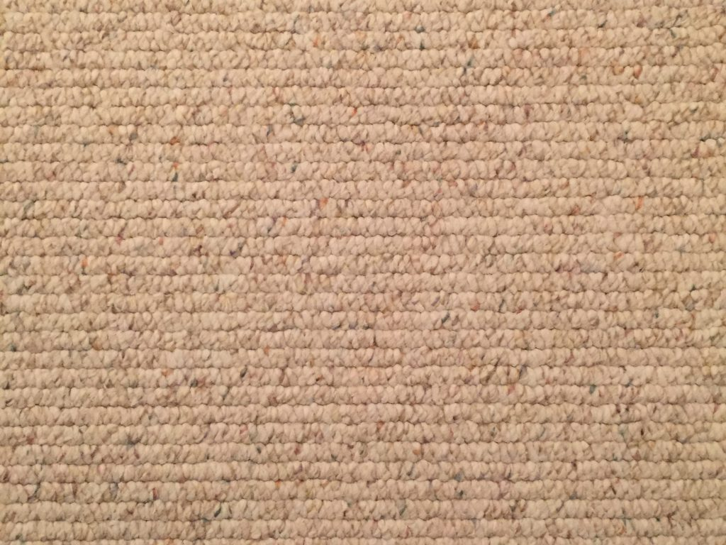 Wide shot of off white carpet texture