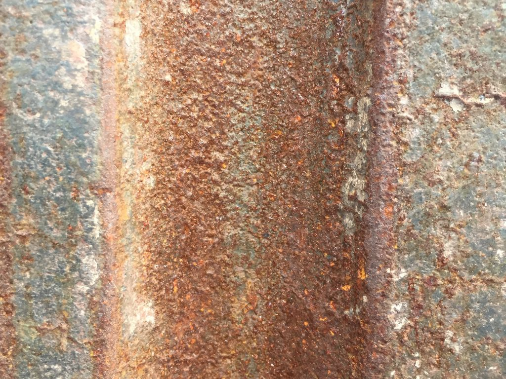 Close up of corroded and rusted metal wall