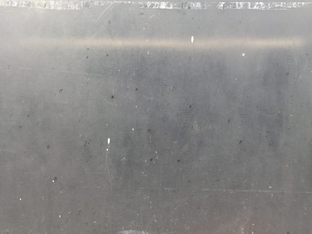 Grungy metal surface with scratches and scuffs