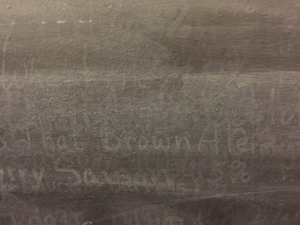 chalkboard with washed out chalk type