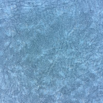 Flat blue surface area covered in frost crystals