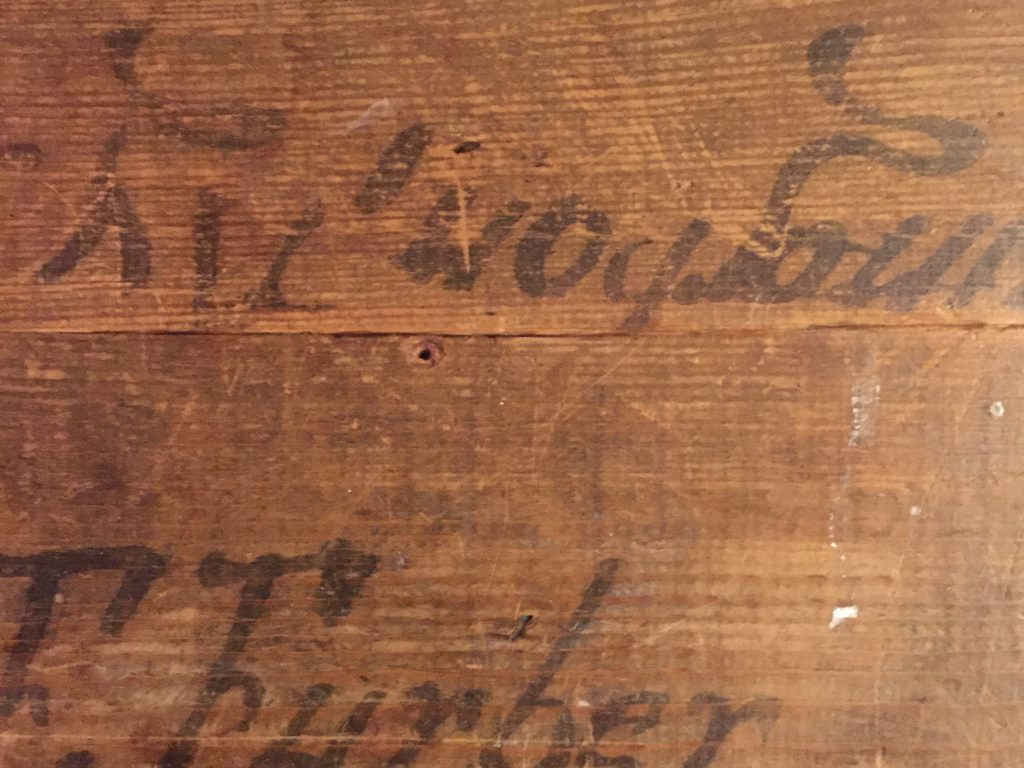 Worn old wood crate with faded calligraphy signage