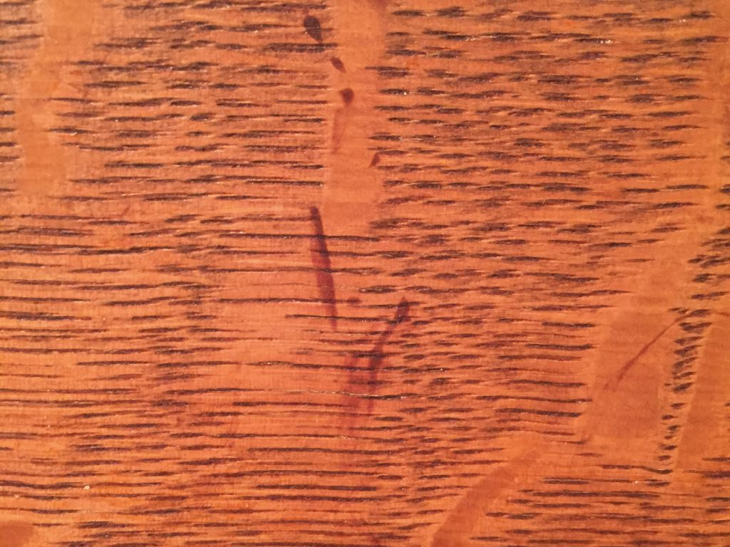Wood table top with thin layers of grain