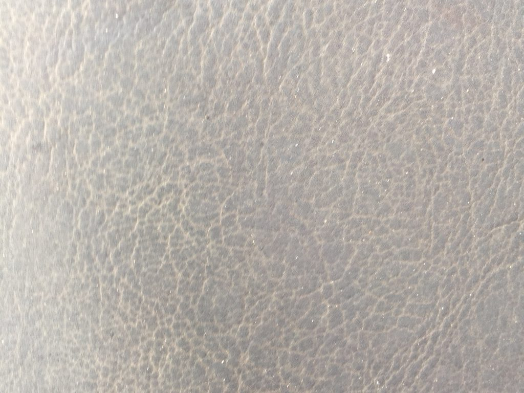Faded leather close up