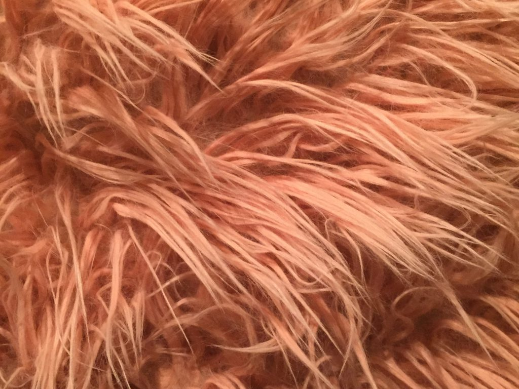 Pink hairy pillow