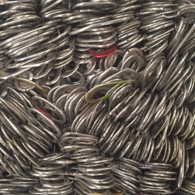 Detailed shot of hundreds of metal can tabs