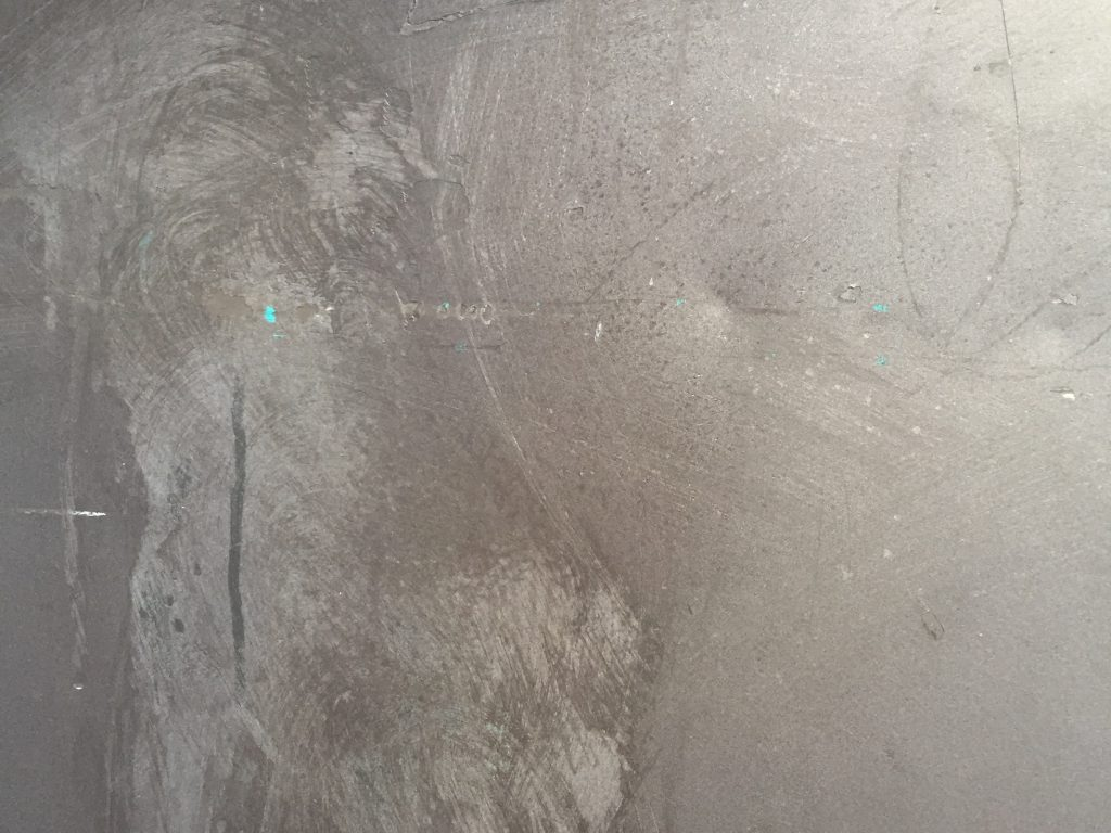 Grey metal plate with scuffs
