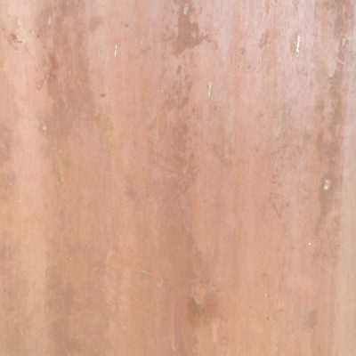 Rusted metal wall with medium red/brown color