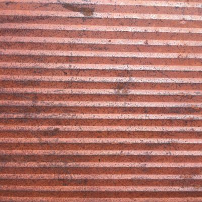 Angled metal wall with rust and corrosion