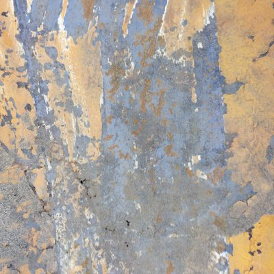 Rusted metal with orange yellow paint
