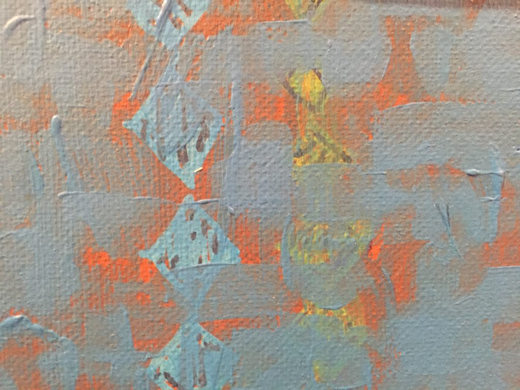 Layered paint with bright orange base covered with blue strokes