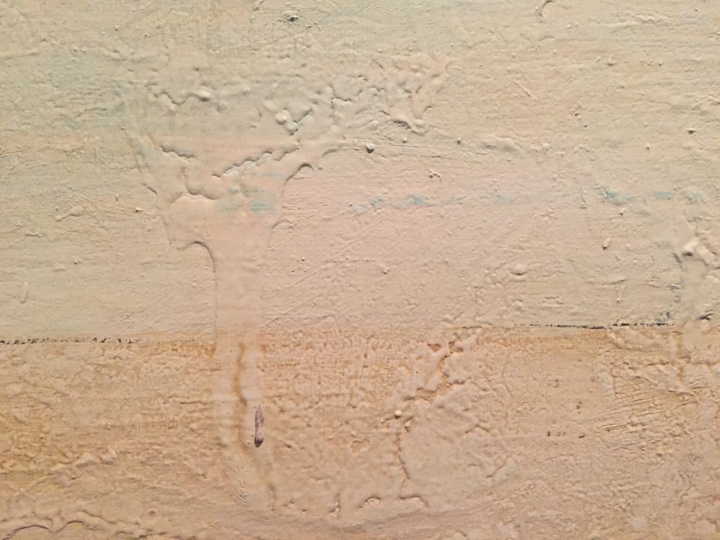 Thick layers of paint with drip marks