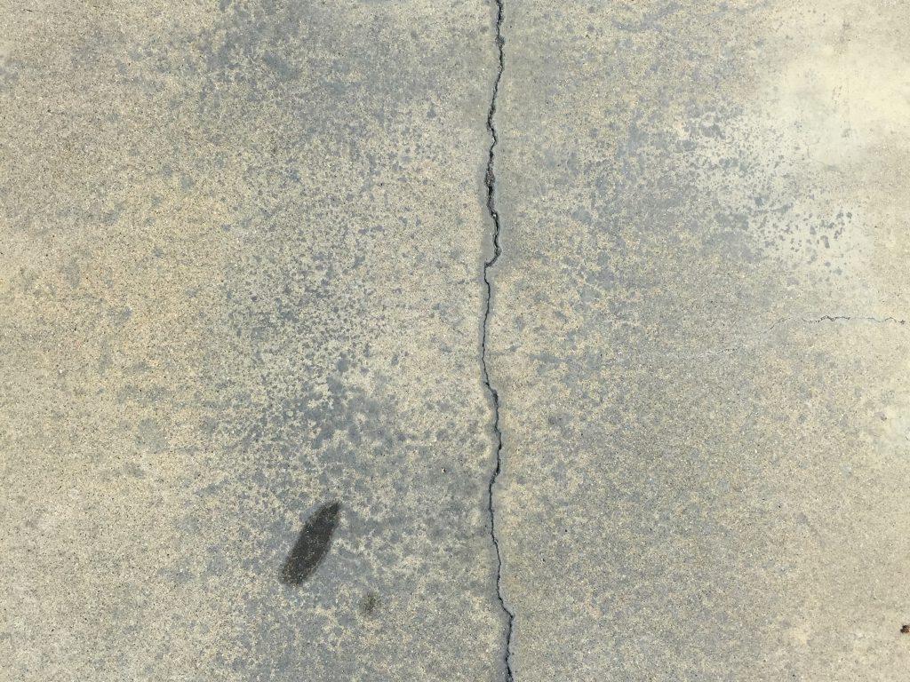 Black pavement with crack