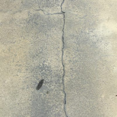 Black pavement with crack