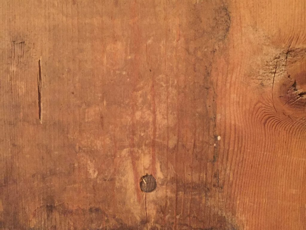 Beat Up 2x4 Wood Close up with nail heads
