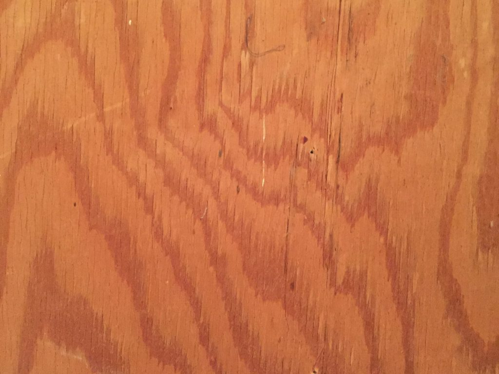 Light red brown plywood with swirling dark tree rings