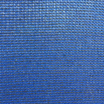 Detailed shot of black stitching on a shiny blue material