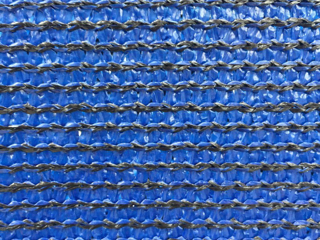 Horizontal black threading in blue plastic