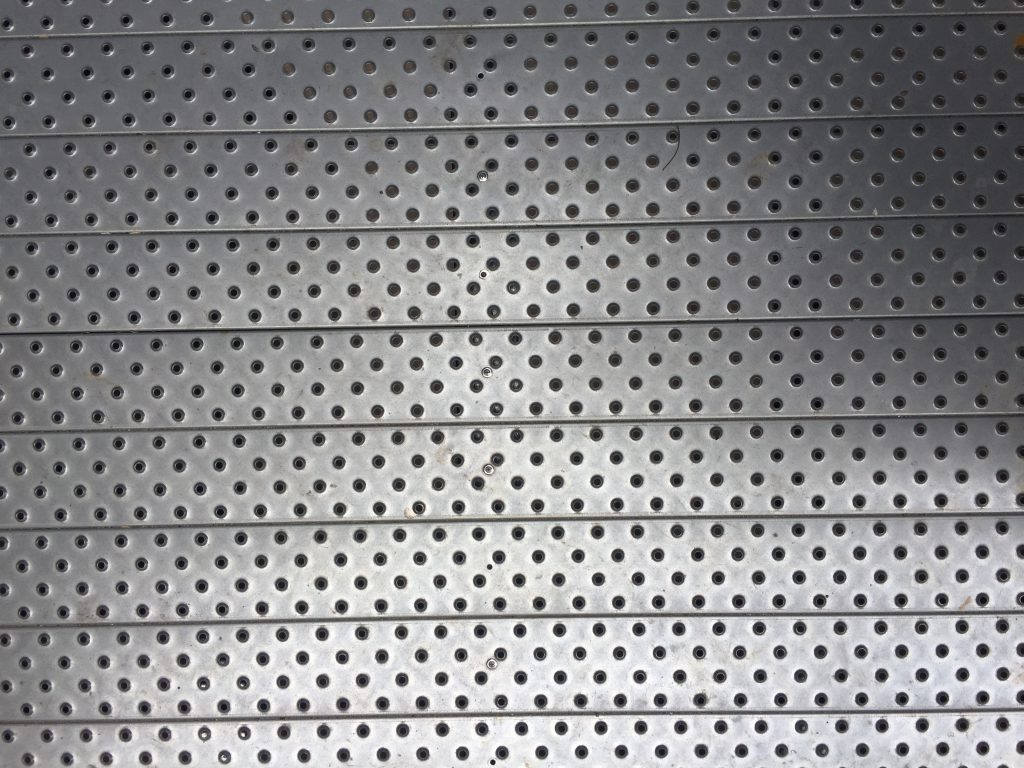 Metallic plate with protruding holes in a diamond pattern