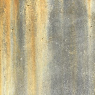Light grey concrete wall with rust streaks
