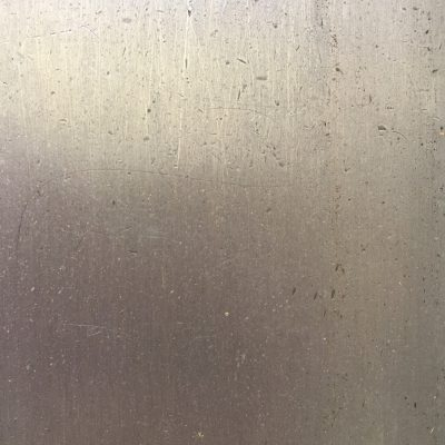 Metal surface with fine scratches and dents
