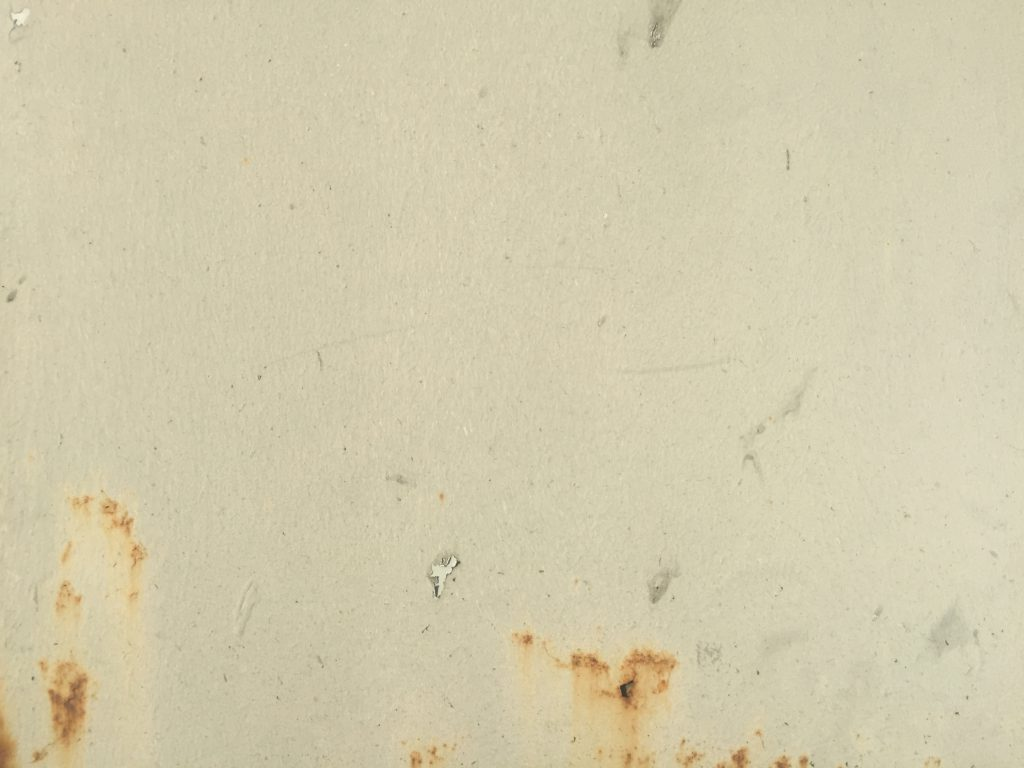 Rust seeping through off white paint