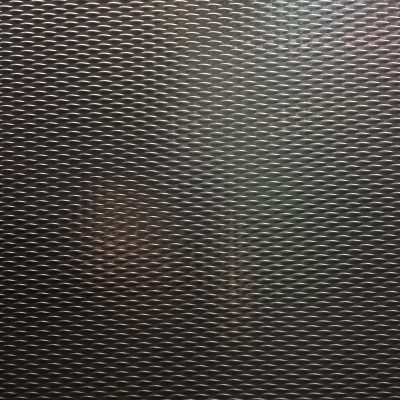 High contrast metal texture with pattern of black/white highlights/shadows