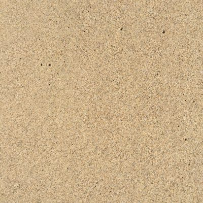 Smooth wet sandy beach close up
