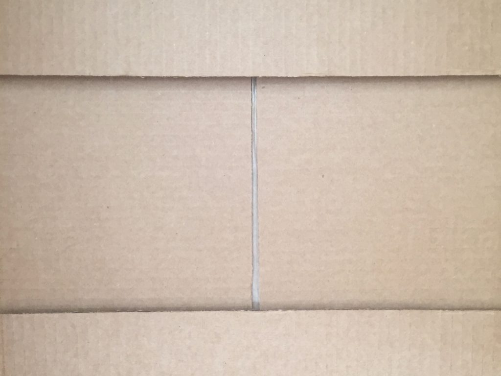 Light brown cardboard box folds