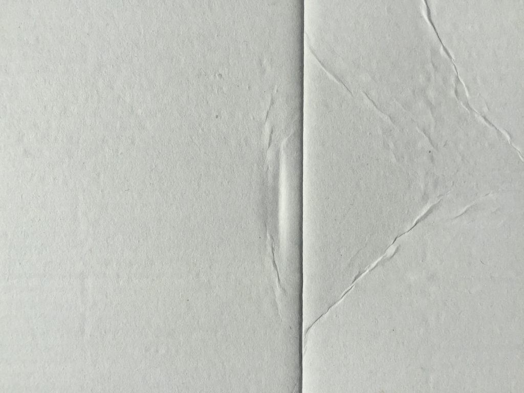 Off white cardboard with line in center