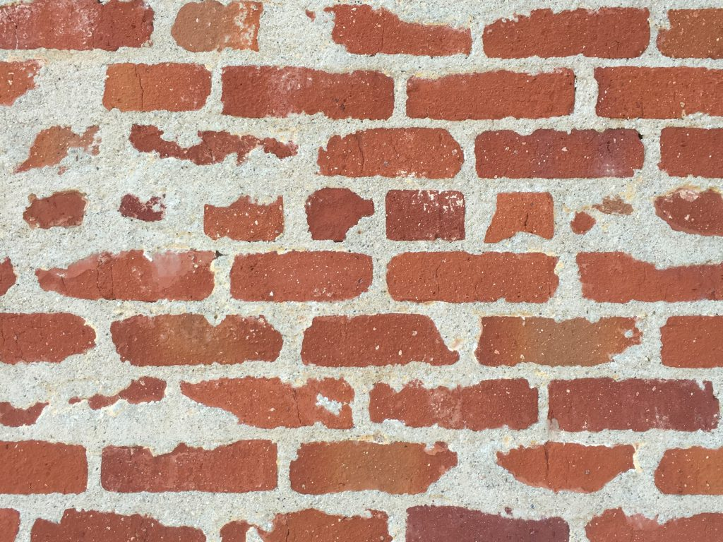 Speckled red brick wall