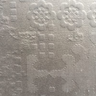 Intricate line work patterns on highly textured wall paper