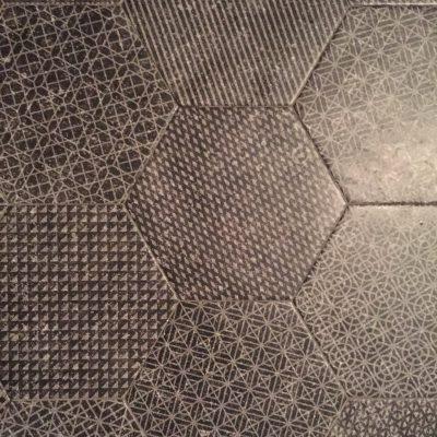 Charcoal grey hexagonal tiles