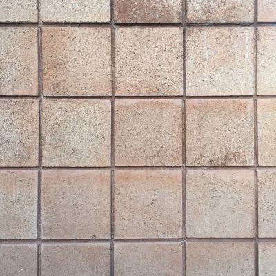 Pale red concrete with square pattern