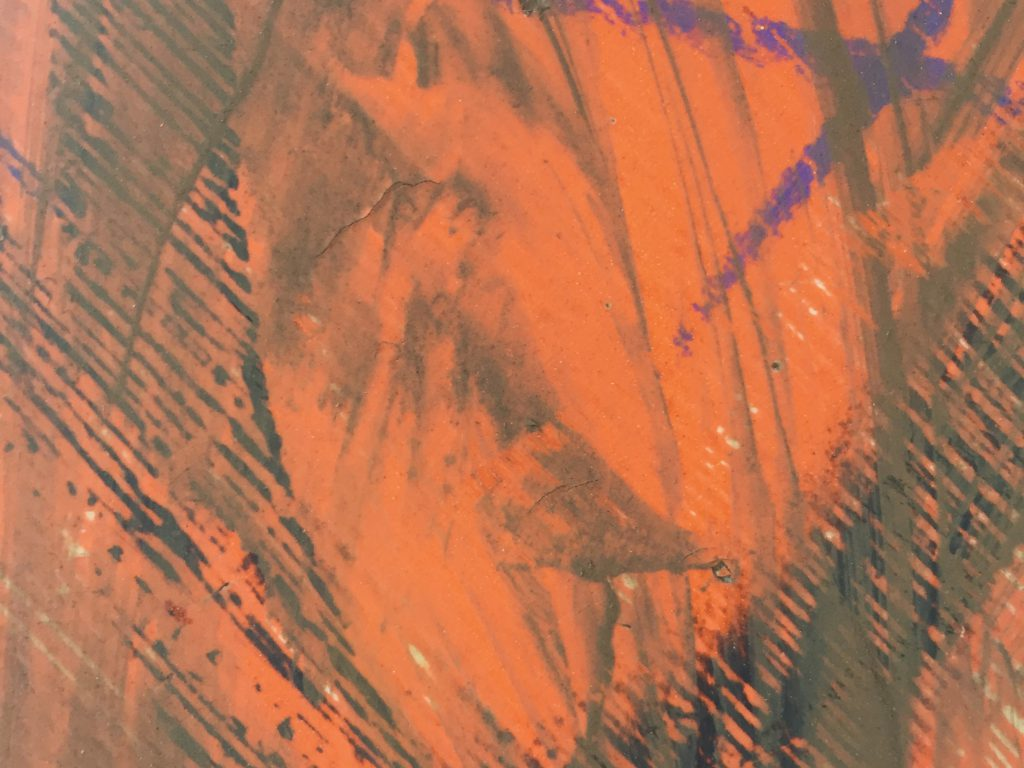 Layers of scuffs and dirt on orange construction sign close up