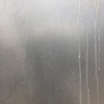 Grungy grey plastic surface with drip marks on right side