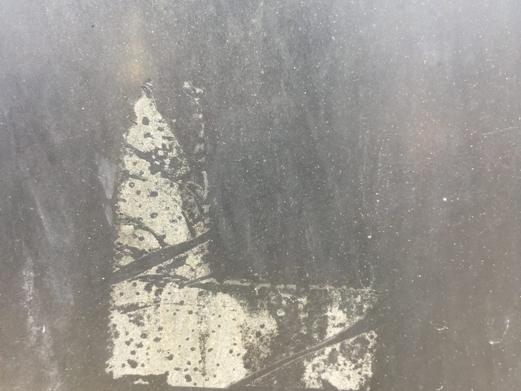 Dirty plastic texture with adhesive residue in the middle