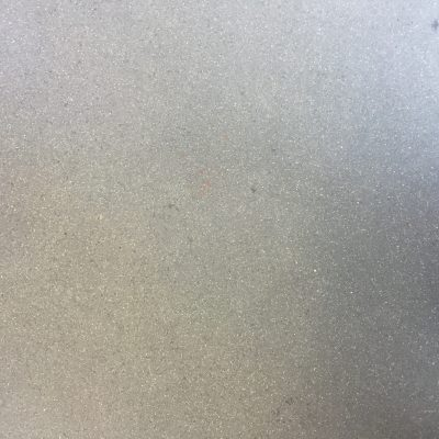 Speckled vinyl flooring texture from a bus, grey/silver color