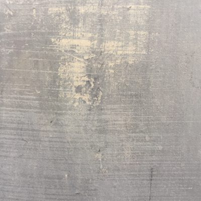 Mute grey concrete texture with yellow-ish scuff marks