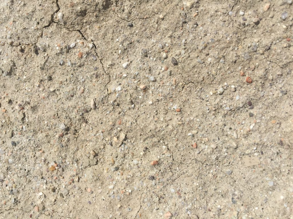 Dried light brown dirt with cracks