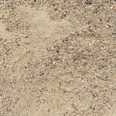 Light brown dirt with small pebbles featuring various shapes and colors