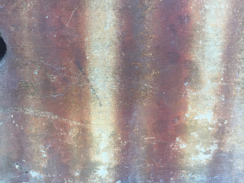 Grunge shot of concrete with dark rust stains