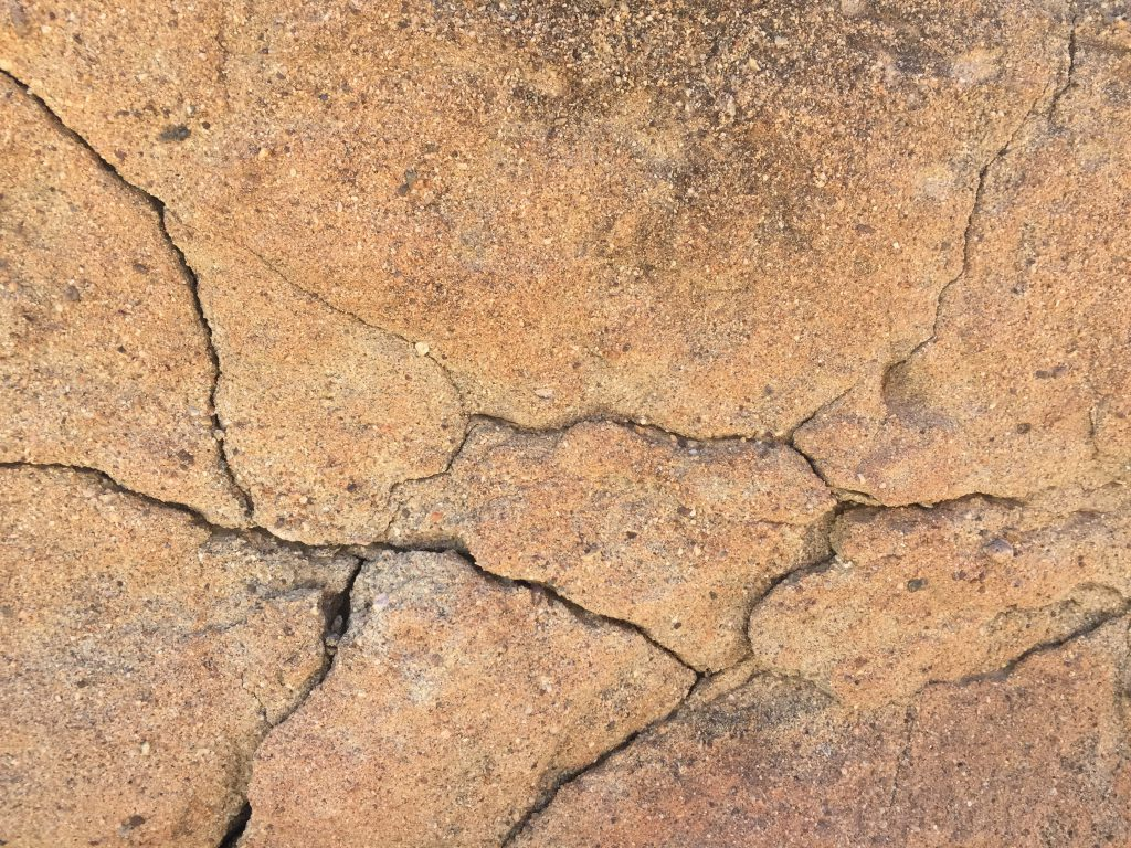 Warm tints on rock with many cracks